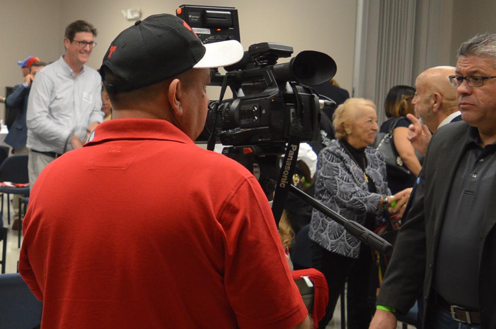 Reporter and camera man from Telemundo