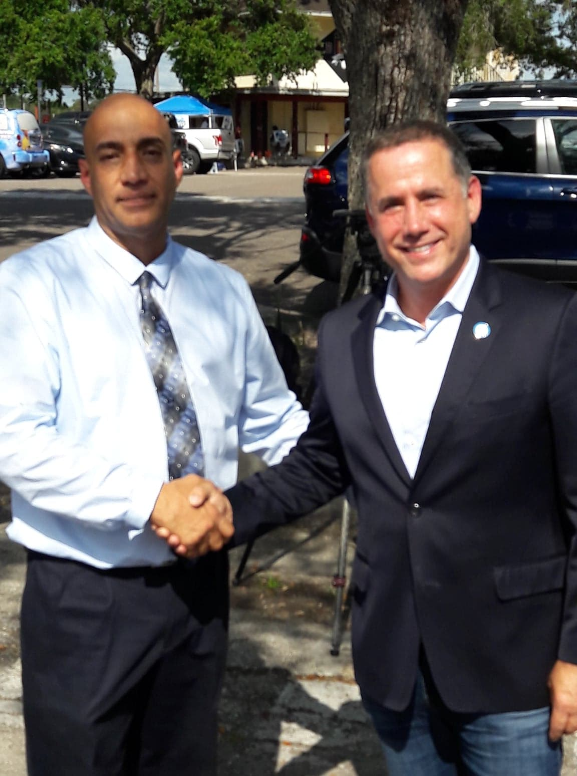 Robert Merced with the former Mayor of Miami Philip Levine