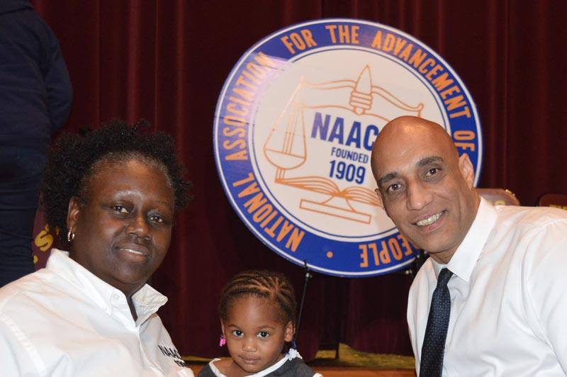 Robert Merced with the president of the Hillsborough branch of the NAACP Yvette Lewis.
